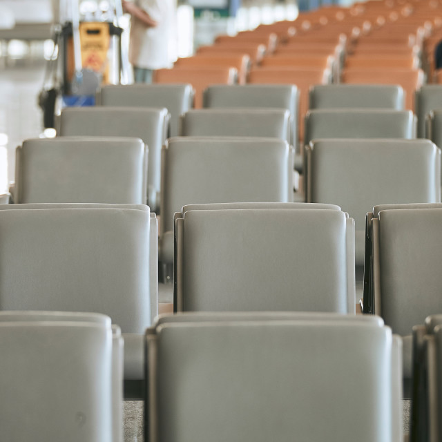 """Row of empty seats in airport departure area"" stock image"