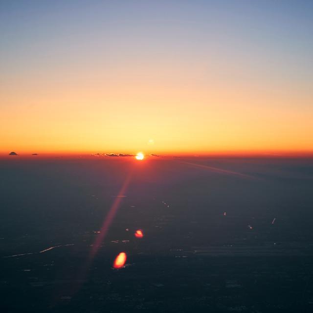 """Setting sun at 30,000 feet"" stock image"