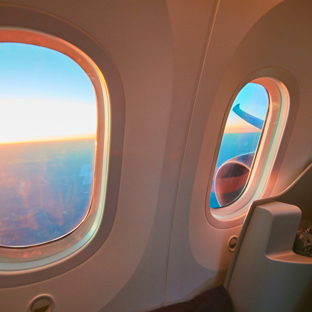 """""""Business class cabin in flight with large windows"""" stock image"""