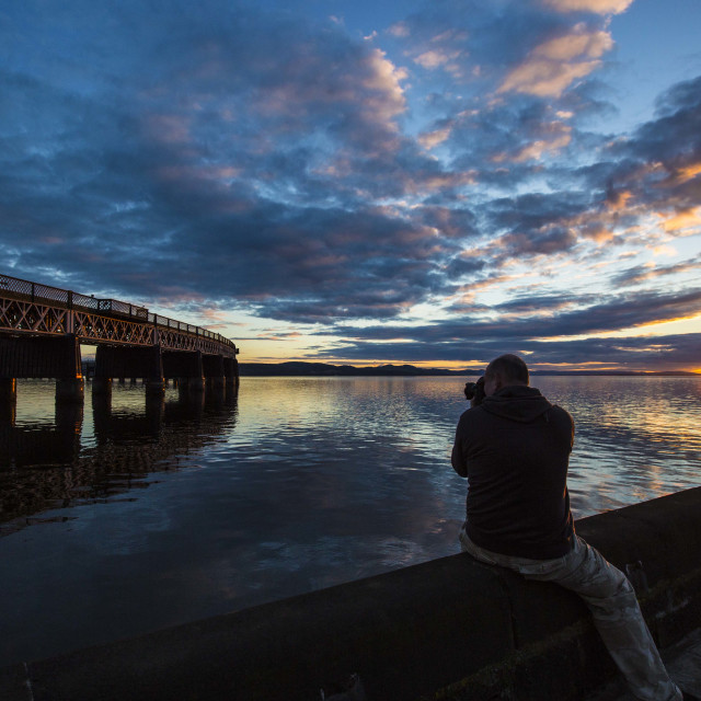 """""""Photo of a photographer at sunset"""" stock image"""
