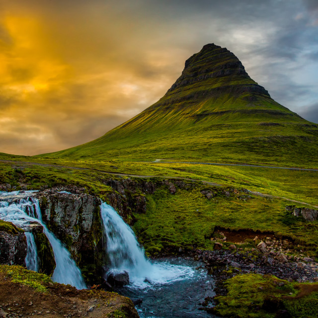"""Kirkjufell and Kirkjufellfoss waterfall at sunset"" stock image"