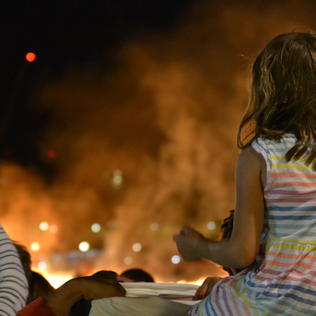 """Child Watches the Fire"" stock image"