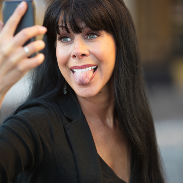 """""""Woman Sticking Out Her Tongue"""" stock image"""