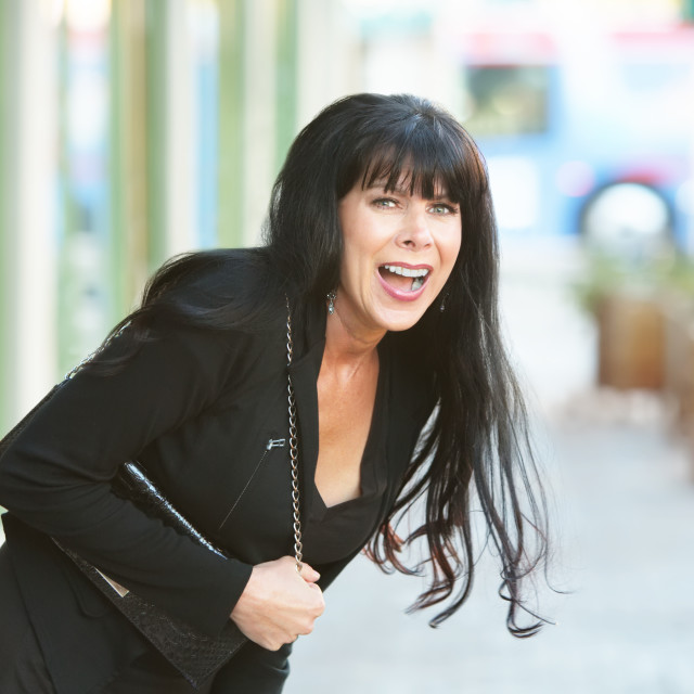 """""""Woman Laughing Outdoors"""" stock image"""