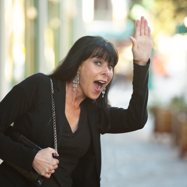 """""""Waving on a Downtown Street"""" stock image"""