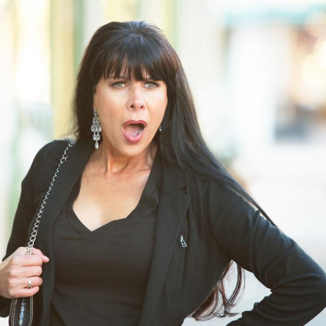 """Surprised Woman on Street"" stock image"
