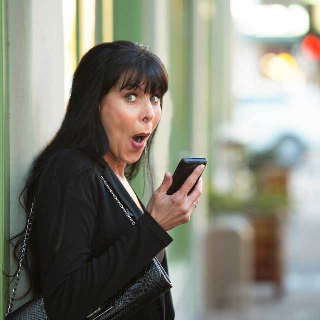 """""""Laughing Woman with Phone"""" stock image"""
