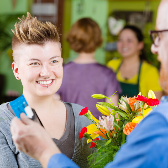 """""""Activity in a busy flower shop"""" stock image"""