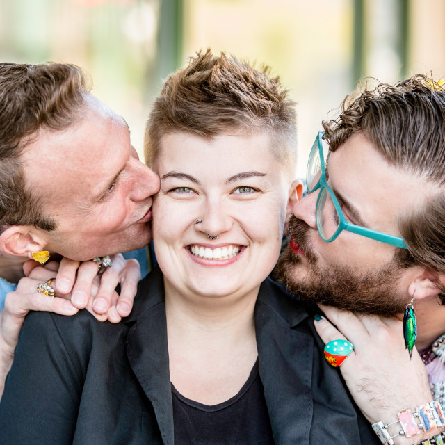 """""""Two Kisses with Three People"""" stock image"""