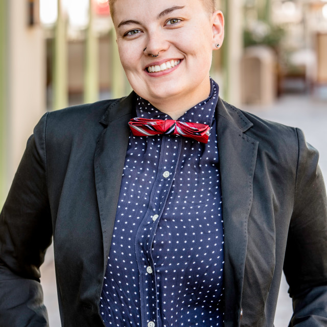 """""""Smiling Dapper Gender Fluid Young Woman"""" stock image"""