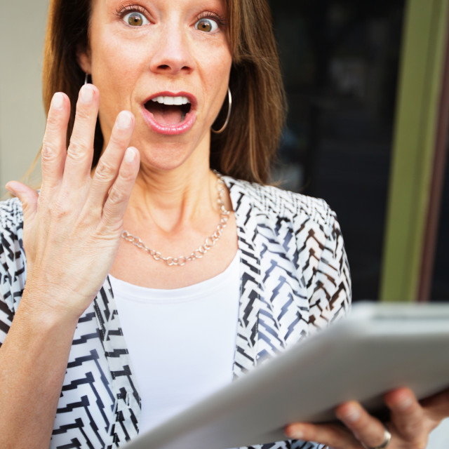 """Startled Woman with Tablet Computer"" stock image"
