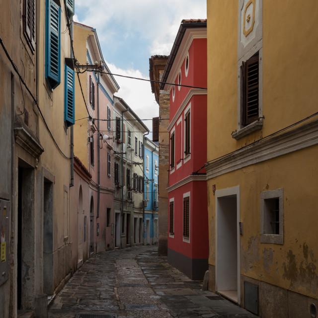 """Narrow cobblestoned street"" stock image"