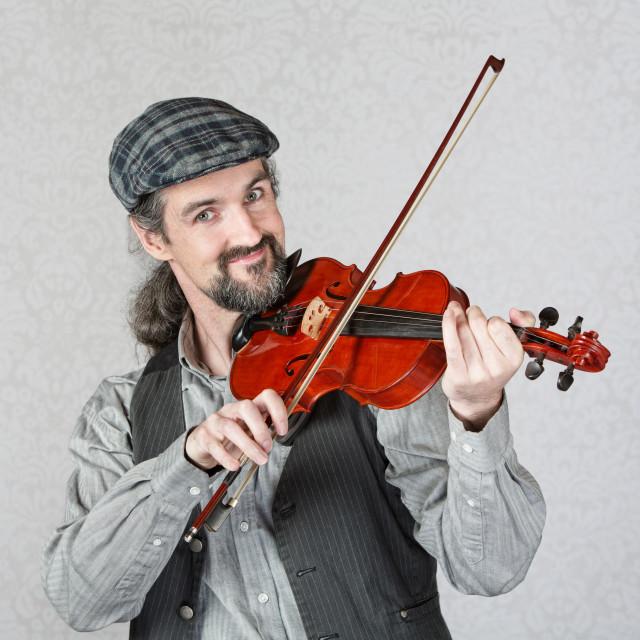 """""""Smiling Irish Fiddler Performing"""" stock image"""