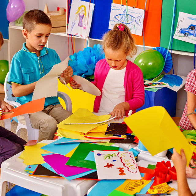 """""""Children make overall project are making something out of paper."""" stock image"""