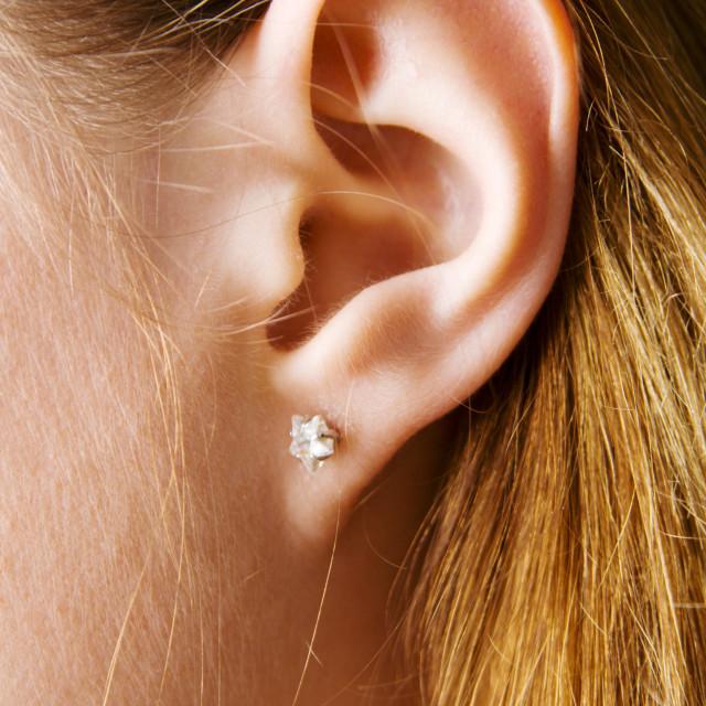 """Closeup photo of a pretty female ear"" stock image"