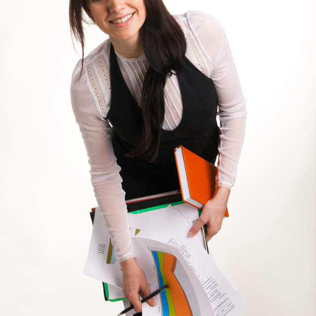 """""""Cheerful businesswoman holding a bunch of documents"""" stock image"""