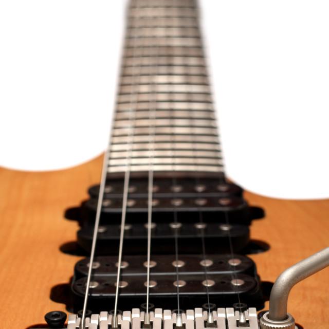 """Closeup of electric guitar bridge"" stock image"