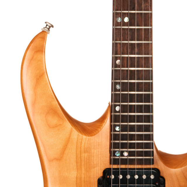 """Toned maple electric guitar closeup"" stock image"