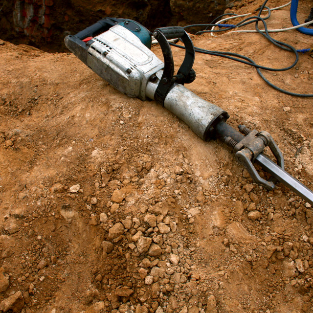"""""""Pneumatic hammer lying on the ground"""" stock image"""