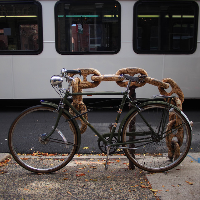 """Bicycle, Public Transport and Chain"" stock image"