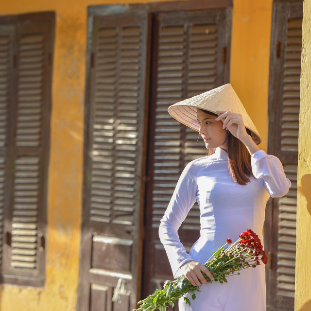 """Beautiful woman with Vietnam culture traditional dress,Ao dai is famous traditional costume ,vintage style,Vietnam"" stock image"