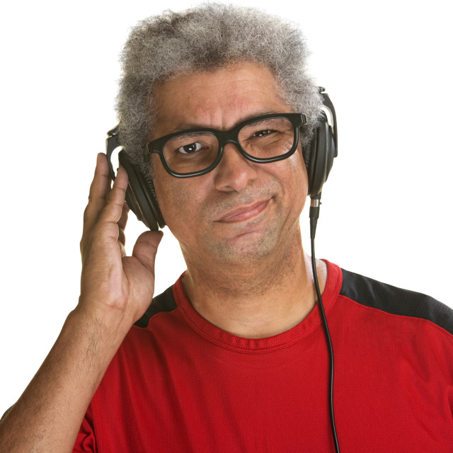 """Squinting Man with Headphones"" stock image"