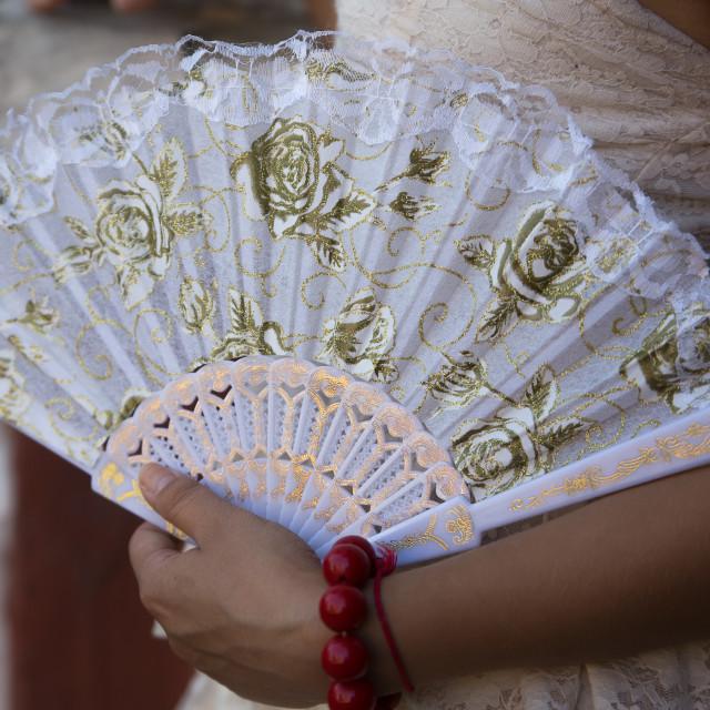 """""""White fan in woman's hands"""" stock image"""