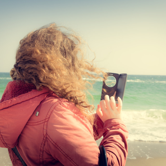 """""""Woman with curly hair with a smartphone"""" stock image"""