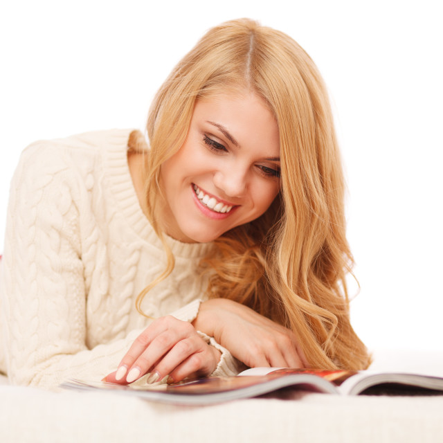 """Young beautiful woman reading a magazine"" stock image"