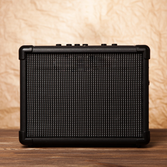"""Guitar amplifier on yellow background"" stock image"