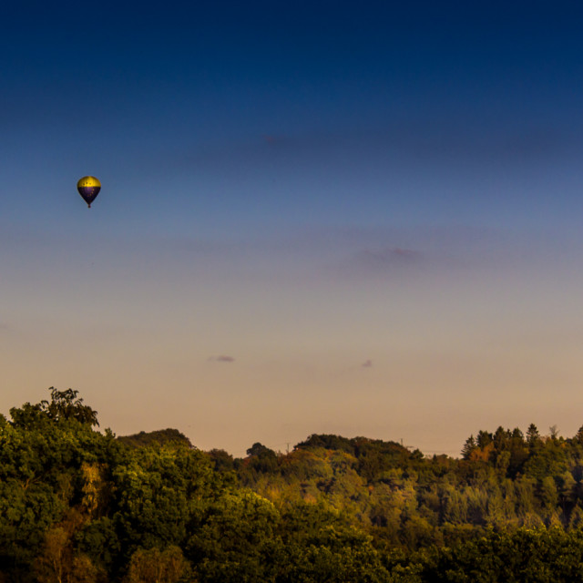 """""""Balloon over the Hills"""" stock image"""