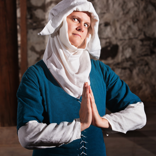 """Sinister Nun in Prayer"" stock image"