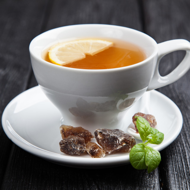 """Cup of tea on dark background"" stock image"