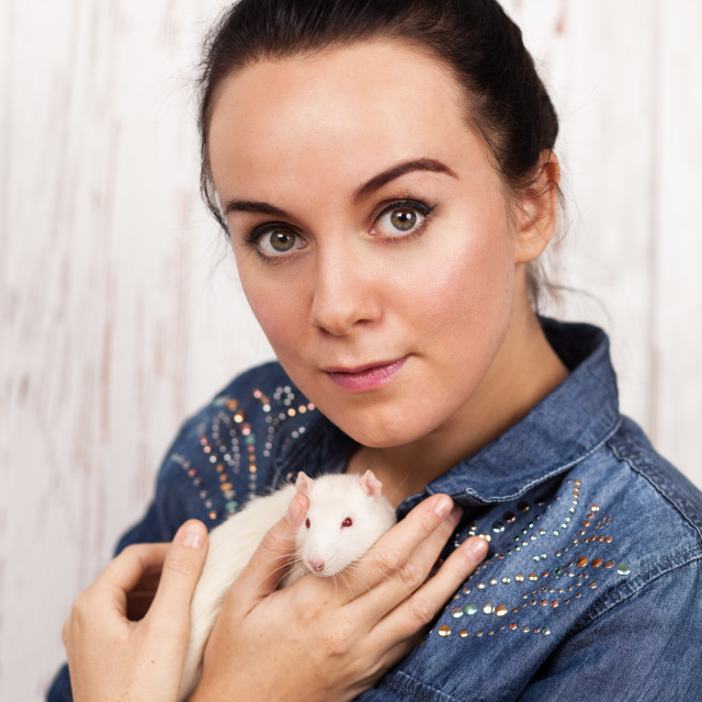 """Young woman with a pet rat"" stock image"