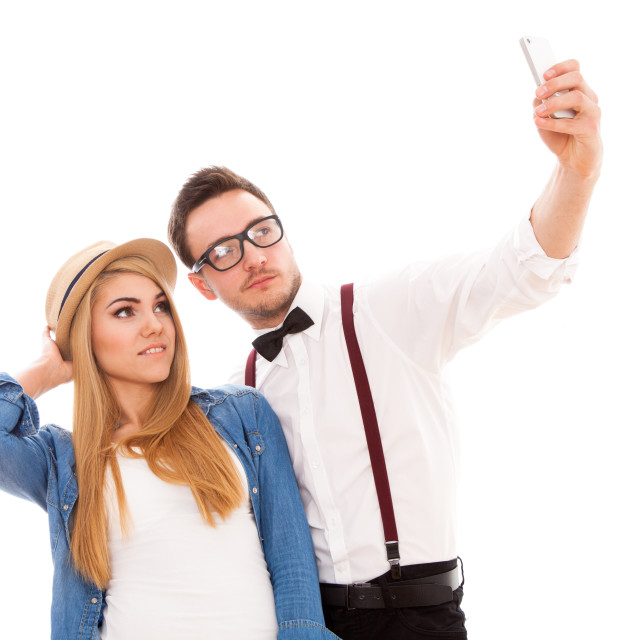 """Young hipster couple making a selfie"" stock image"