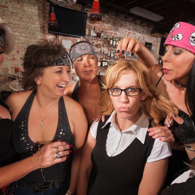 """""""Cruel Women Teasing Nerd"""" stock image"""