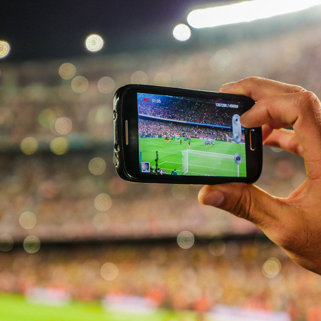 """""""Supporter football team recording goal with mobile phone camera."""" stock image"""