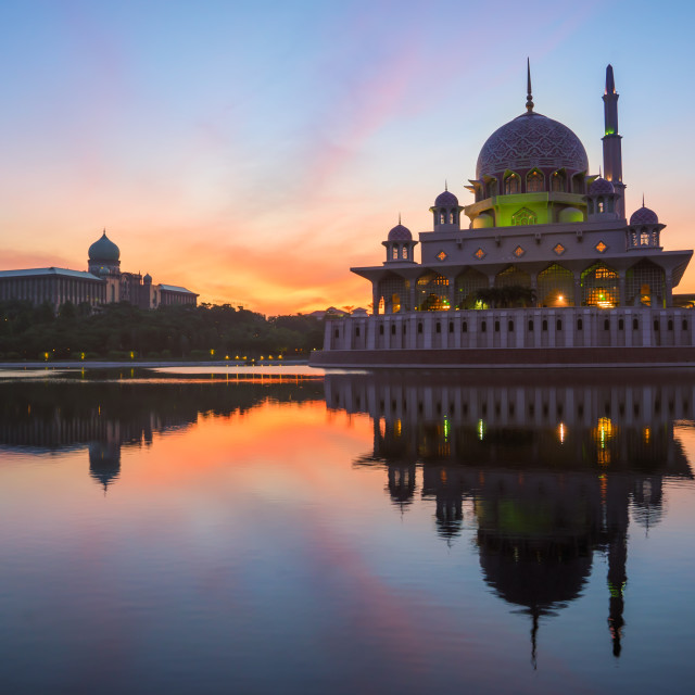 """""""Beautiful Sunrise over a Mosque by the lake with colorful clouds"""" stock image"""