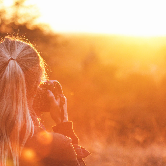 """Snapping the Sunset"" stock image"