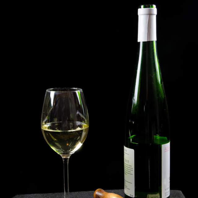 """""""Bottle and glass of white wine with utensiles"""" stock image"""