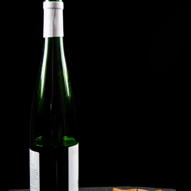 """""""Uncorked wine bottle with utensiles"""" stock image"""