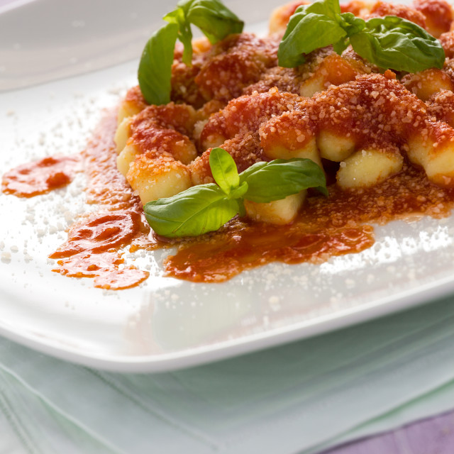 """Gnocchi, Italian pasta with tomato sauce basil and grana cheese"" stock image"