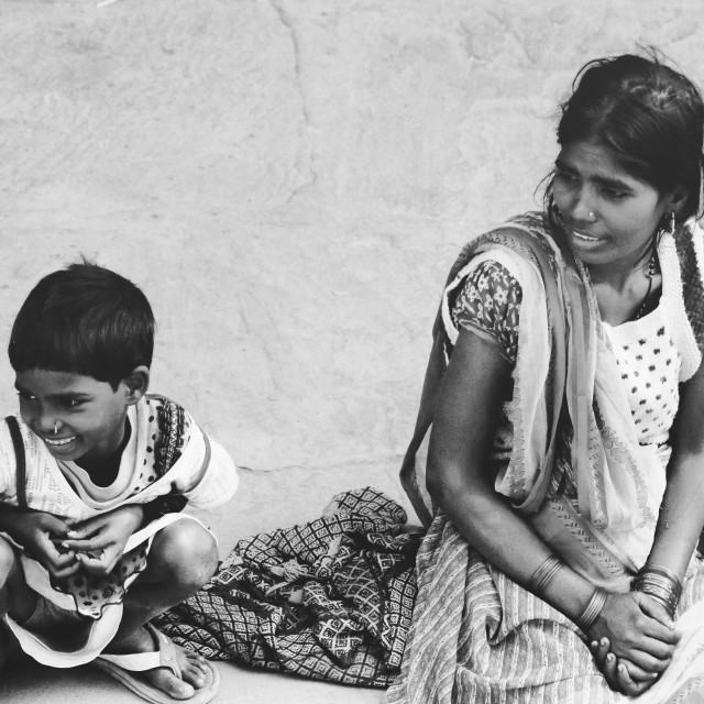"""Indian street life - mother and child smiling"" stock image"