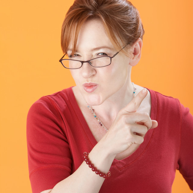 """Suspicious Woman With Eyeglasses"" stock image"