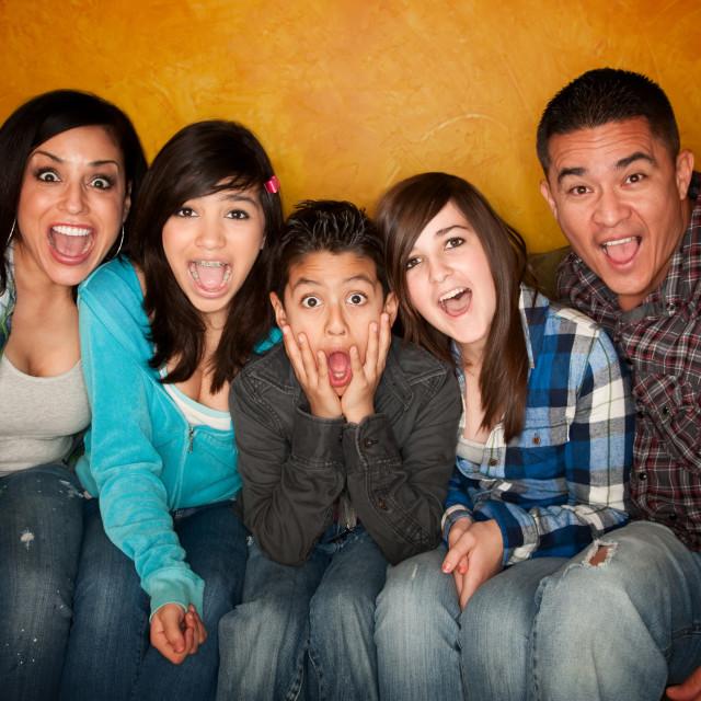 """Hispanic Familywith Big Reaction"" stock image"