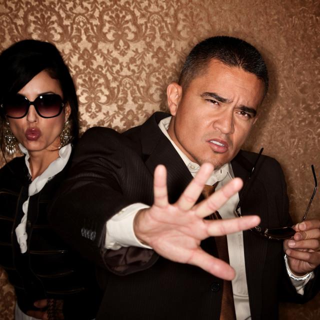 """Hispanic couple caught in a photographer flash"" stock image"