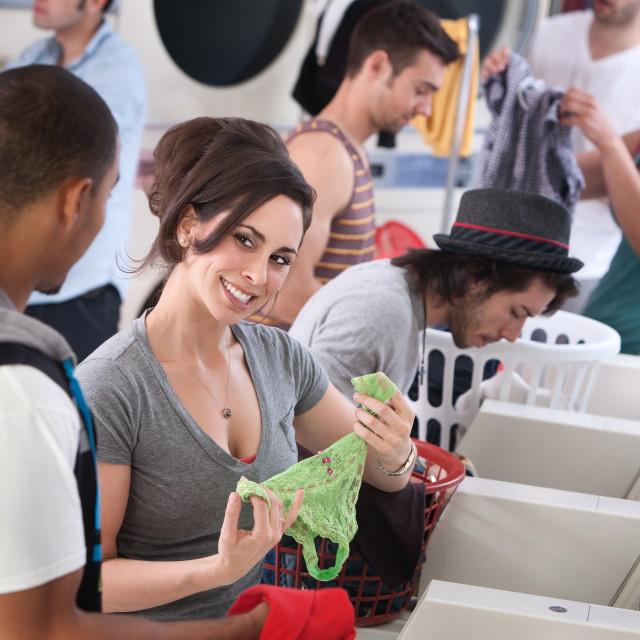 """Laundromat Flirt"" stock image"