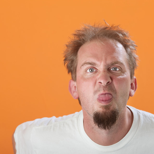 """""""Man Sticks Out His Tongue"""" stock image"""