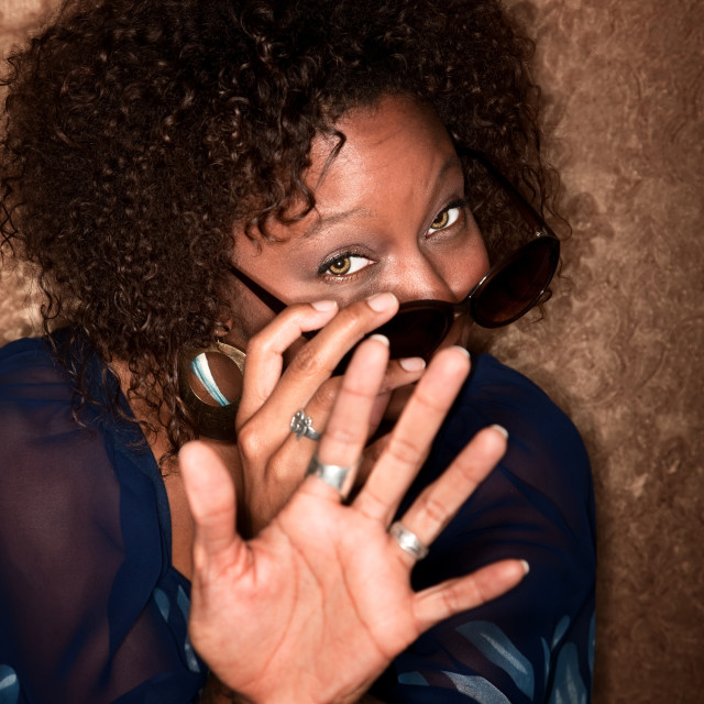 """""""African American Woman fending off a Camera"""" stock image"""