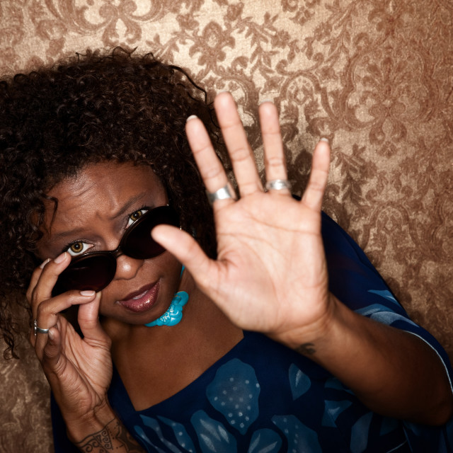 """""""Woman caught in a photographer's flash"""" stock image"""